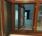 供应贝科利尔高端定制128系列铝包木外开内带金钢网门窗